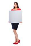 Femme dans le signe de représentation rouge Photographie stock libre de droits