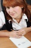 Femme dans le sourire de bureau Photos libres de droits
