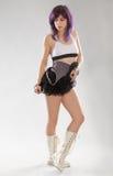 Femme dans le tutu, espadrilles de genou les hautes, et le dessus de culture Photographie stock libre de droits
