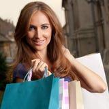 Femme dans les achats images stock