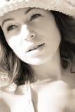 Femme dans les rayons de soleil Photographie stock