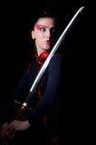 Femme dans martial japonais Photos stock