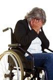 Femme dans pleurer de fauteuil roulant Photos libres de droits