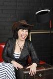 Femme dans un chapeau de cowboy Photographie stock libre de droits