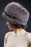 Femme dans un chapeau de fourrure Photos libres de droits