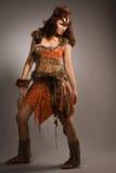 Femme dans un costume de fourrure de l'Amazone Photographie stock libre de droits