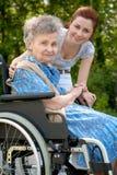 Femme dans un fauteuil roulant Photos stock