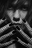 Femme dans un réseau Photographie stock