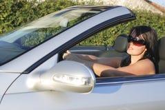 Femme dans un véhicule Photographie stock libre de droits