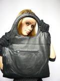 Femme dans une robe avec les gants noirs Images stock