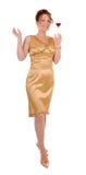Femme dans une robe de cocktail avec une boisson Photographie stock libre de droits