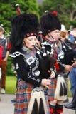 Femme de bande de tuyau aux jeux de montagne de Newtonmore Photographie stock libre de droits