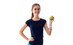 Femme de centimètre tenant une pomme Image libre de droits