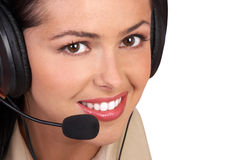Femme de centre d'attention téléphonique Photo stock