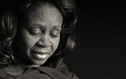 Femme de couleur pensive Photographie stock libre de droits