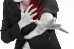 Femme de crise cardiaque Femme d'affaires à l'aide des mains Image libre de droits