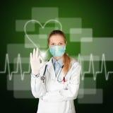 Femme de docteur avec l'électrocardiogramme Photo stock