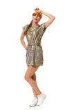 Femme de Fashinable dans les espadrilles et la robe d'or Photo libre de droits