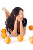 Femme de forme physique avec l'orange Image stock