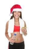 Femme de forme physique avec le chapeau de Noël Images stock