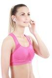 Femme de forme physique dans le style de sport se tenant sur le fond blanc Photos libres de droits