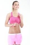 Femme de forme physique dans le style de sport se tenant sur le fond blanc Images libres de droits