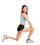 Femme de forme physique faisant l'exercice de mouvement brusque Images libres de droits
