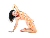 Femme de forme physique streching dans le studio Photos stock