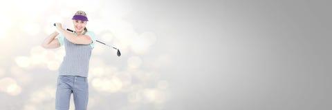 Femme de golf avec la transition photos stock