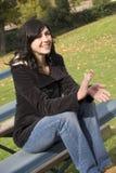 Femme de gradins au soleil Photo stock
