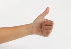 Femme de main gauche montrant des pouces sur le fond blanc Photographie stock libre de droits