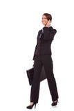 Femme de marche d'affaires au téléphone Photo libre de droits