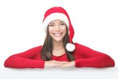 Femme de Noël de Santa se penchant sur le panneau-réclame de signe photo libre de droits