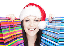 Femme de Noël retenant des sacs à provisions au-dessus du petit morceau Images libres de droits