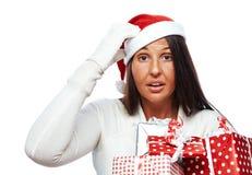 Femme de Noël soumise à une contrainte  Photographie stock