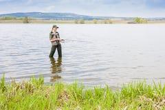 Femme de pêche Image stock