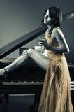 Femme de piano Images stock