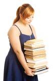 Femme de poids excessif tenant des livres Image libre de droits