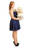 Femme de poids excessif tenant les livres lourds Image libre de droits