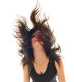 Femme de réception d'isolement avec le vent dans le cheveu Photographie stock
