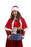 Femme de Santa avec des cadeaux. Images stock