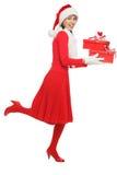 Femme de Santa courant avec des cadeaux Photo stock
