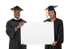 femme de signe d'homme de graduation Photo libre de droits