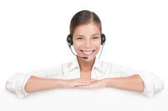 Femme de signe de service à la clientèle avec l'écouteur Image stock
