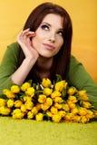 Femme de source avec la fleur Photographie stock