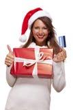 Femme de sourire achetant des cadeaux de Noël Images libres de droits