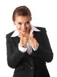 Femme de sourire d'affaires affichant le pouce vers le haut du geste Photographie stock libre de droits