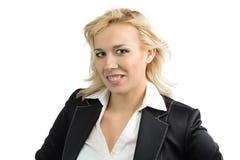 Femme de sourire d'affaires avec les cheveux débordants Photographie stock libre de droits