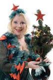 Femme de sourire dans le costume de l'arbre de Noël Image libre de droits