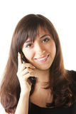 Femme de sourire de brunette avec le téléphone Photo libre de droits